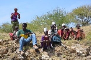 Tanzanian geology students and local Massai in the rift flank of the Lake Natron rift